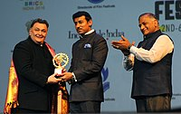 The Minister of State for Information & Broadcasting, Col. Rajyavardhan Singh Rathore felicitating the Actor Rishi Kapoor, Rathore at the inauguration of the BRICS Film Festival, in New Delhi on September 02, 2016...The Minister of State for External Affairs, General (Retd.) V.K. Singh is also seen..